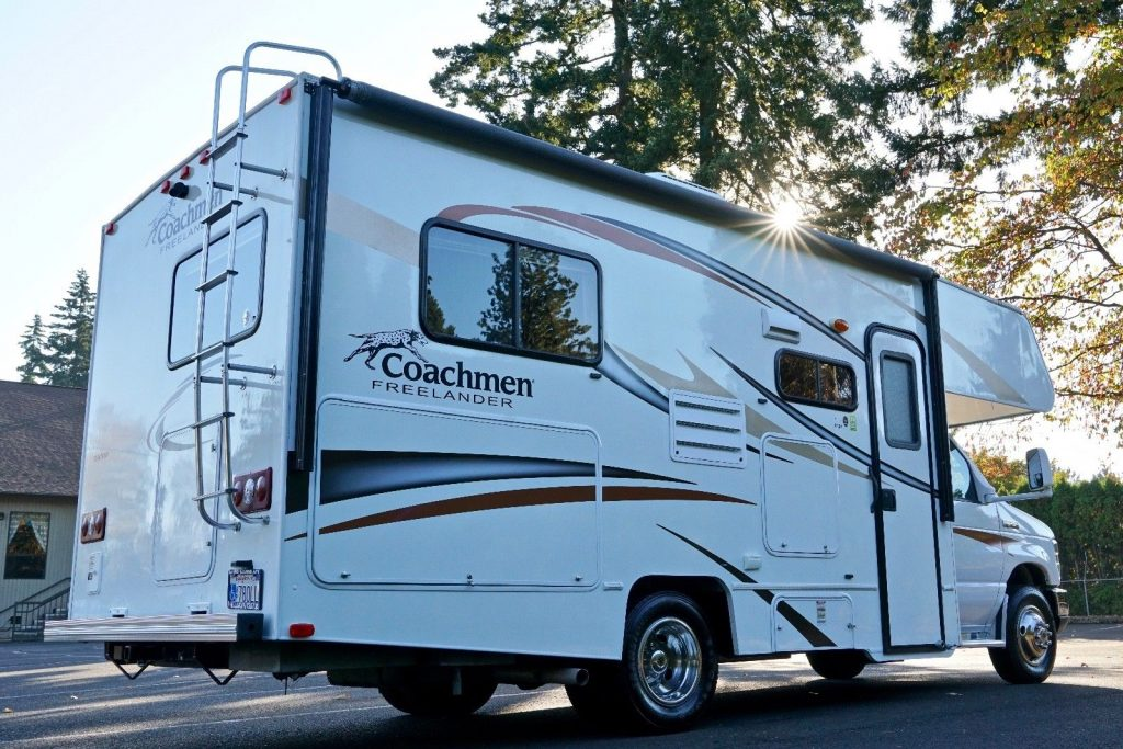 low miles and loaded 2013 Coachmen Freelander 21QB camper