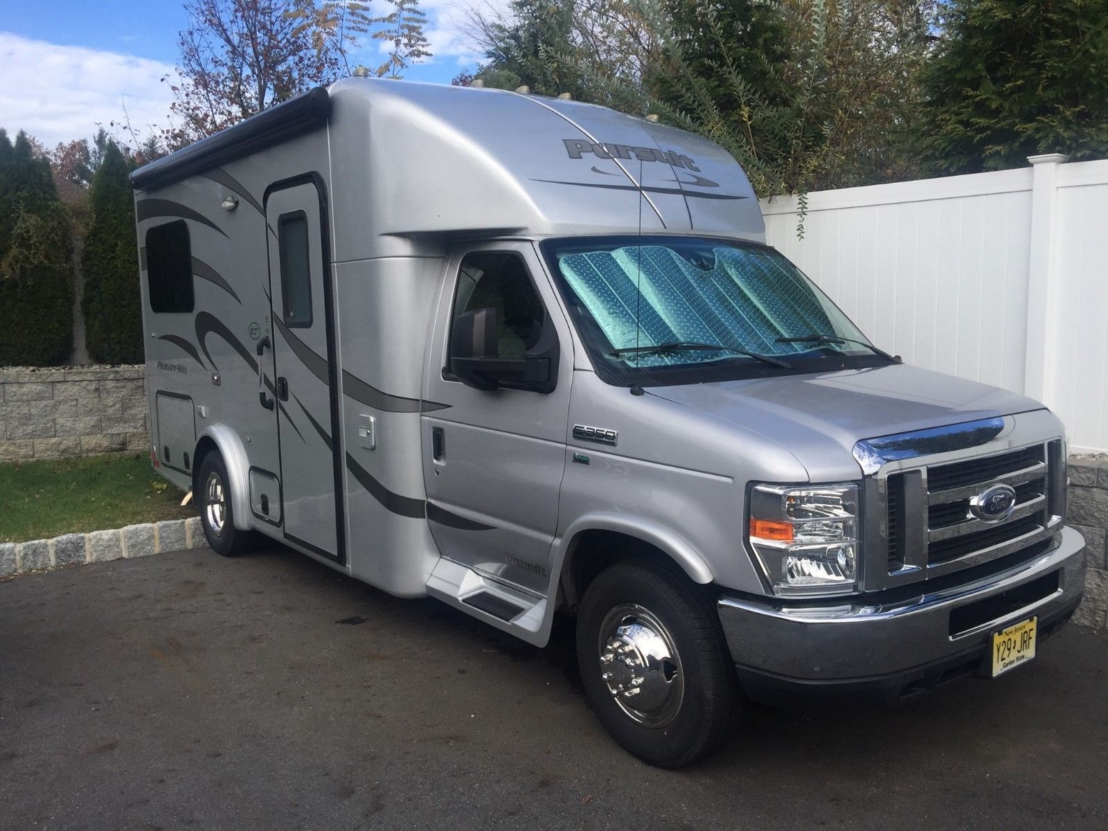 lots of storage 2014 Ford E350 Pleasure Way Pursuit B+ camper for sale