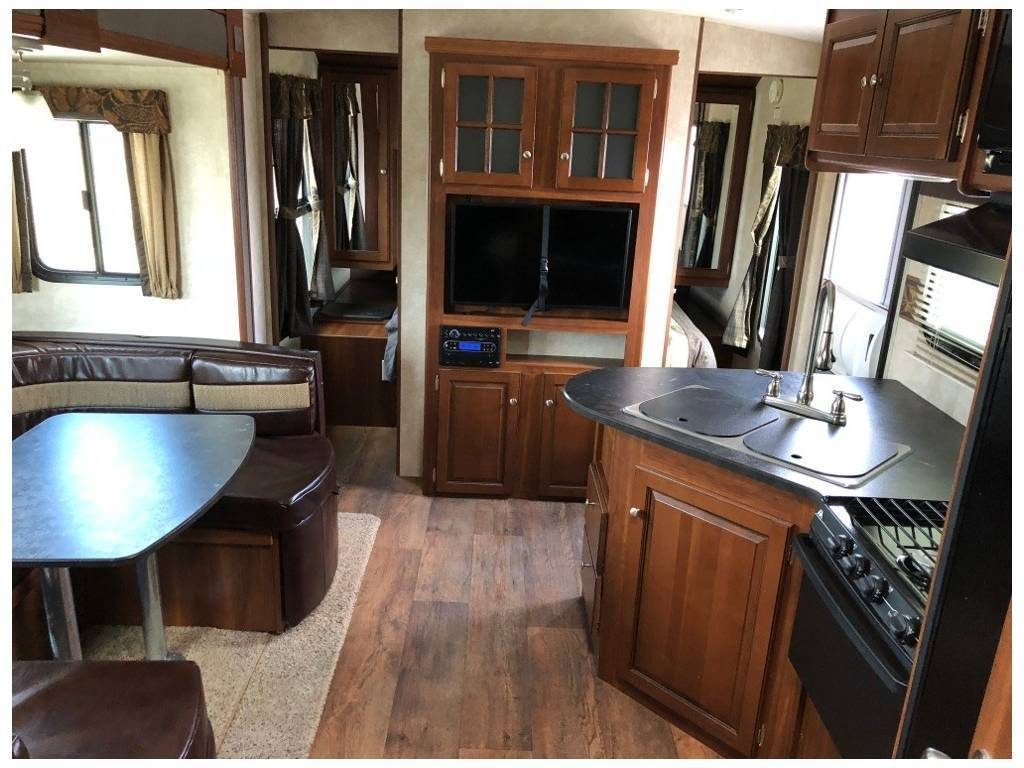 loaded 2015 Keystone Bullet Premier 22RBPR camper