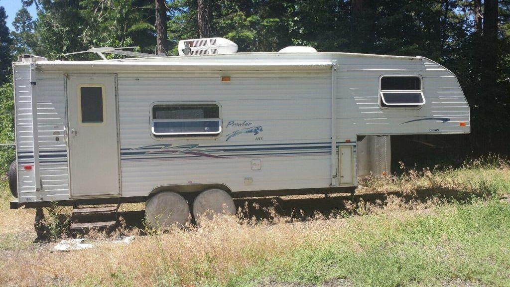 solid 2000 Fleetwood Prowler lite camper