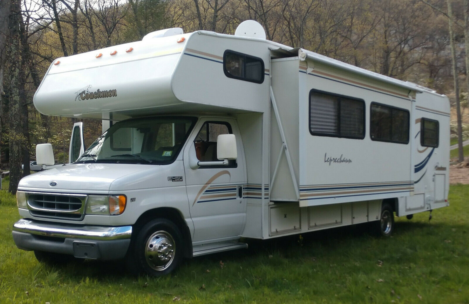 low miles 2000 Coachmen Leprechaun camper for sale